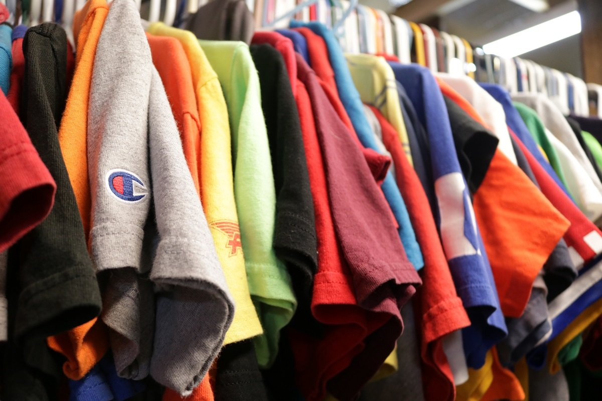 SafeHaven Now's thrift store clothing rack with t-shirts