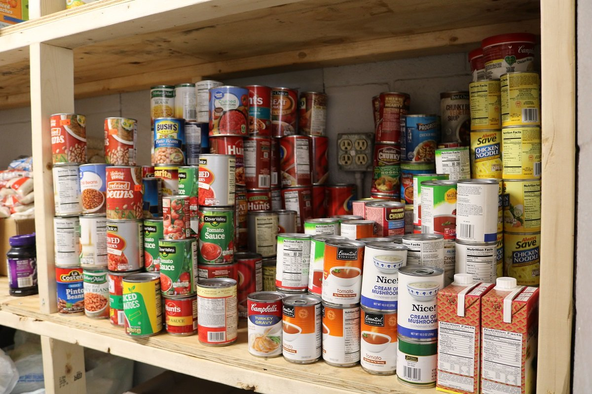 SafeHaven Now's food pantry shelves with canned goods