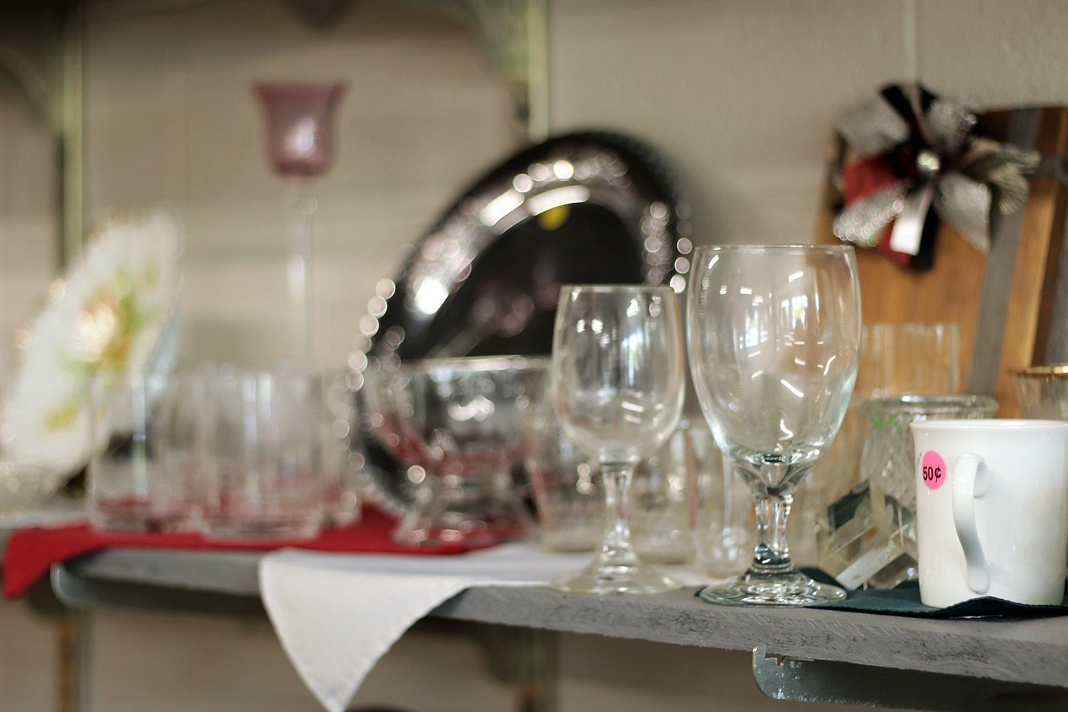 Dinner plates and glasses for sale one day at SafeHaven Now thrift store in Rogersville, MO