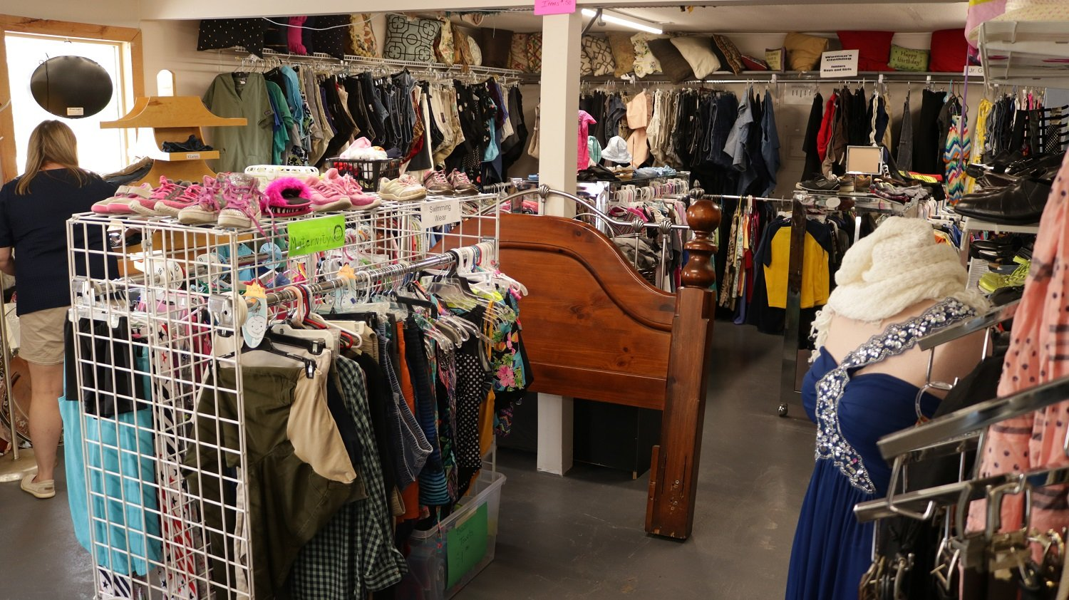 The interior of Safehaven Now thrift store in Rogersville, MO, with clothing, furniture, and other goods